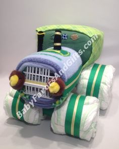 John Deere inspired Tractor Diaper Cake is built from About 60 Diapers size 1 (8lb to 14lb) Fleece Blanket Receiving Blanket Pair of Baby Socks Bodysuit Dishwasher Basket About 60 Diapers size 1 (8lb to 14lb) Fleece Blanket Receiving Blanket Pair of Baby Socks Bodysuit Dishwasher Basket