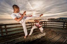 Cool capoeira on an Oakland Pier overlooking San Francisco and the Bay bridge.     (Copyright: Candersonclick)