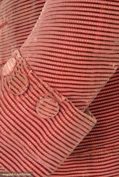 """Cuff and button detail of a 1760s frock coat, horizontally striped maroon silk velvet with cut, uncut and voided areas, narrow standing band collar, fitted sleeves with 4"""" cuff. Augusta Auctions"""