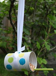 Soup can bird feeders. Cute for recycling! And a kids craft. So many possibilities!