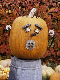 With a drainpipe mouth, caster ears, and two eyes made out of brackets - repurpose old hardware or purchase inexpensive pieces to decorate your #fall pumpkins this season #FallDIY ~ @bystephanielynn