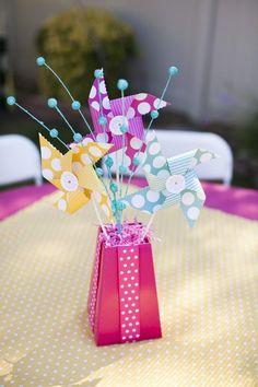 Centerpiece at a Pinwheels and Polka Dots 1st Birthday Party with Full of Adorable Ideas via Kara's Party Ideas | KarasPartyIdeas.com #LittleGirl #Party #Ideas #Supplies #centerpiece #polkadot #pinwheels