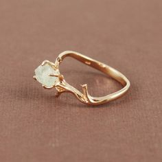 gold branch ring.
