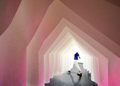 Gabled houses created from paper form this installation by Japanese architect Kotaro Horiuch.