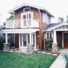 We love the combination of natural elements on this home's facade! 20 ways to add curb appeal: http://www.bhg.com/home-improvement/exteriors/curb-appeal/ways-to-add-curb-appeal/?socsrc=bhgpin080812woodsidingstonepillars#page=17