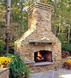I LOVE outdoor fireplaces