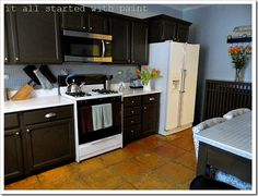 Brown painted cabinets on pinterest brown cabinets for Builder grade oak kitchen cabinets