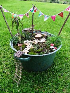 Fairy Garden fun by Tilly at This, That and Everything Inbetween ~ love the jaunty pennants