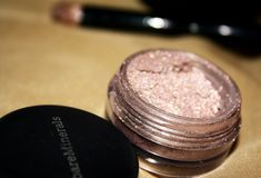 Bare Minerals nude beach.....best highlighter: ULTA