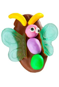 "Easter Butterfly -- These ""Nutterbutter cookie[s] dipped in milk chocolate and decorated with peanut M&Ms, gummis and runt candies"" are for sale and inspiration from Sweet Hut Candy, Wisconsin Dells, WI."