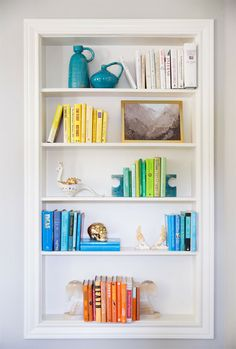color organized bookshelf.
