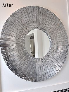 Brilliant. mirror made out of metal rulers.