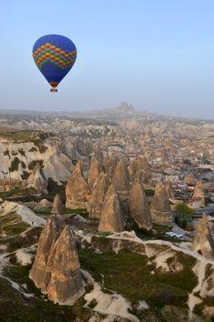 Floating over the scenic fairy chimneys of Cappadocia, Turkey By: Sara
