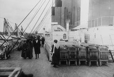 Top Deck of the Titanic: Passengers stroll passed chairs on the deck of the Titanic (1912).