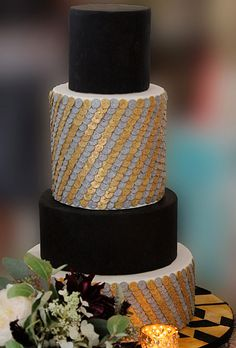 Brides.com: 34 Stunning Wedding Cakes for a Winter Wedding. A Four-Tier Wedding Cake with Silver and Gold Paillettes by Sweet Elements Cakes