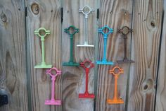 Recycled Wine or Beer Bottle Tiki Torch Hangers IN MULTIPLE COLORS. $14.95, via Etsy.