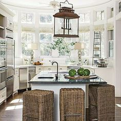 Beach House Kitchen | This kitchen was refreshed with a coat of China White. It is kept clean and streamlined with a mostly white collection of china and flatware. | SouthernLiving.com