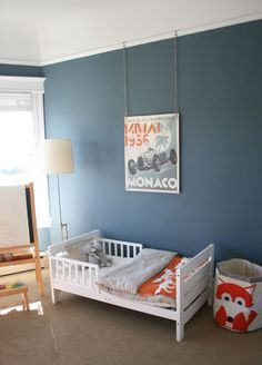 Guest room / millers | wall color and accent colors (Benjamin Moore Philipsburg Blue), with white beds, and a tight woven tan carpet