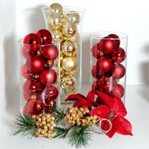 Holiday Home Decor: Fill glass vase with ornaments, perfect for your mantle or table centerpiece! Get everything from Dollar Tree!