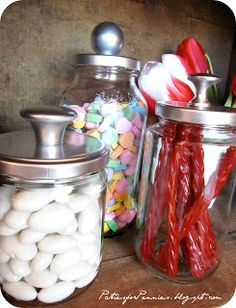 Parties For Pennies: DIY Apothecary Jars made from spaghetti sauce (or other types) of jars, spray paint lid and add knob to the top!