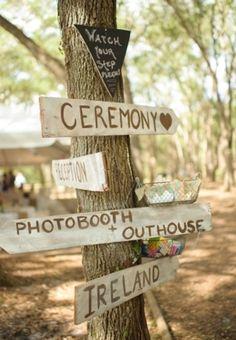 Rustic outdoor wedding directional sign.