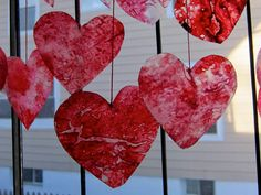 melted crayon hearts make fabulous decorations - love these by the window!