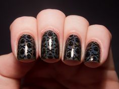 Urban Outfitters Eyes Wide Shut (a black creme) stamped over HITS Zeus using Vivid Lacquer plate VL001. From Chalkboard Nails.