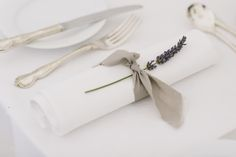 Burlap napkin ties with a simple sprig of lavender--simple and elegant. (Photo by Mary Sylvia Photography)