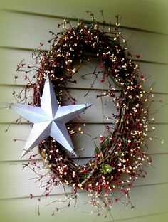 "Gorgeous Wreath....Oval Shaped with Mixed pip berries, and 12"" Distressed White star ... Pip Berries are Slate Blue, Plum, Cream and Mustard.......GORGEOUS Color...........  $39.99 http://www.primitivehomedecorandmore.com/"
