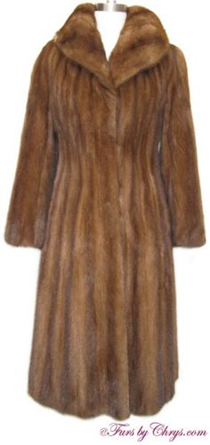 Mahogany Mink Coat #MM714; $1000; Excellent Condition; Misses 0 - 4.  This is a beautiful genuine natural mahogany mink fur coat. It has Furs by Le Nobel of Athens label as well as an Anna Nateece Original label and features a large rolled collar. This mahogany mink coat has somewhat of a fitted waist and a wide sweep which drapes beautifully. If you desire a touch of luxury in your life, buy this enchanting fur coat! When you put it on, you will feel like a new woman!