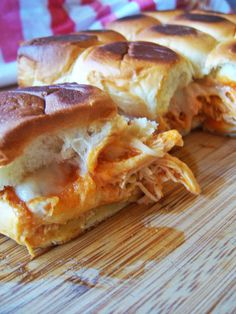 Crockpot Buffalo Chicken Sliders -- boneless chicken breasts, buffalo sauce, ranch seasoning, hawaiian sweet rolls, swiss cheese