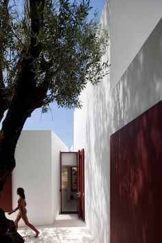 House Of Agostos by Pedro Domingos Arquitectos. I like the bold contrast between the white walls and the deep brown-red of the shutters.
