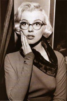 Marilyn Monroe sporting cat eye glasses