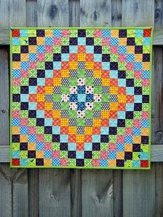 I like the concentric squares, I should have enough squares of certain fabrics to do this...