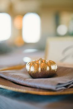 gold pumpkins on place settings // photo by Delbarr Moradi