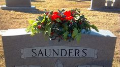 Flower arrangement securely anchored to headstone.