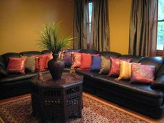 Moroccan Color Splash--revisited, Moroccan style living room that I also had posted last year. I recently had all my woodwork stained a walnut color and my walls painted. Also, replaced all the light fixtures throughout the house. So....have I improved this space?Missing some artwork for the walls....still looking!, Living Rooms Design