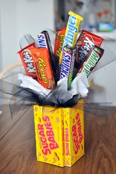 "Sweet Father's Day ""Bouquet""...of candy!  What a fun and easy to make gift with the boxes of candy as the ""vase"" to hold all the rest.  Could give this as a birthday or graduation gift as well.  Instructions included."