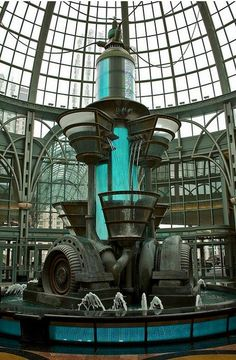A steampunk fountain at a shopping mall... location unknown.