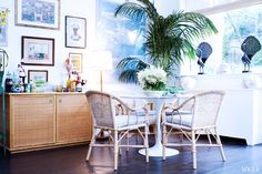 The Emerging Design Trends You Need to Know About // Eclectic dining space with tulip table, bistro chairs, and palm tree