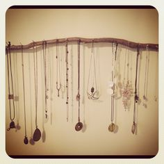 I used a piece of a branch I found on my walk and nailed a few nails into it. I then hung it on my wall. A necklace holder that cost me a few pennies :)