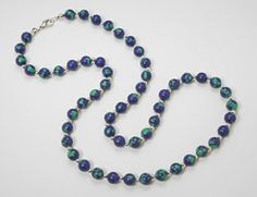 Arctic Opal Necklace    This beautiful bead Necklace is made of Arctic Opal composite stone, hand strung in Alaska with silver beads. Arctic Opal composite is a beautiful mixture of Azurite-Malachite, hand cut, shaped, and polished. Sure to make a beautiful gift for that someone special. Match this necklace with our Arctic Opal earrings for that special gift.  Approximate Size: 6mm & 8mm beads   Length 20 - 24 inch (45 - 68cm)