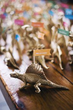 gold dinosaur figurine escort cards, photo by Altmix Photography, styling by Juli Vaughn Designs http://ruffledblog.com/modern-atlanta-wedding #weddingideas #escortcards #seatingchart