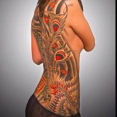 Back- rib tattoo.