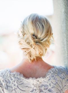 Hairstyle - Messy Updo - See more here: http://www.StyleMePretty.com/2014/05/16/a-monochromatic-inspired-wedding-shoot-part-ii/  Photography - CarmenSantorelliStudio.com