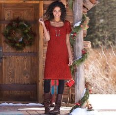 A simple sheath turns spectacular in rose-patterned lace, a luscious sangria color. Short sleeve with scalloped lace sleeves and hem. Cotton/nylon