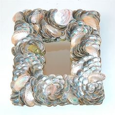 Opalescent silvery seashell mirror