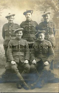 Undated photograph of five soldiers in uniforms, including berets. (Brant Historical Society)