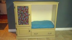 a recycled pet bed from an old entertainment center. #upcycled #entertainment #center or #armoire