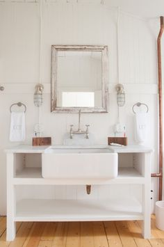 White bathroom with exposed copper pipes in seaside cottage | Remodelista
